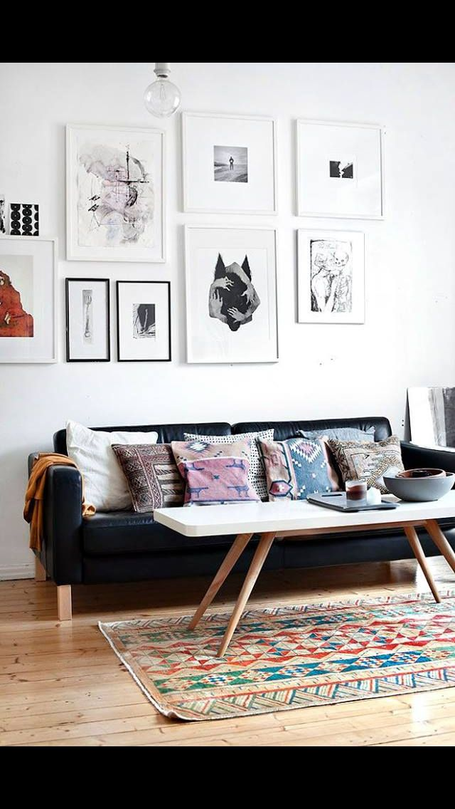black couch + Hipster pillows, tray +candles +white walls