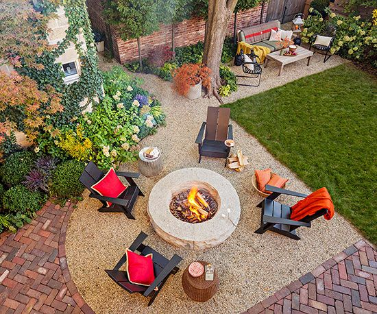 The highlight of this small garden landscape is a firepit with welcoming chairs. Placing the seating spot just off a paved patio, as well as creating a secondary seating spot near the fence, helps the small backyard feel more spacious.