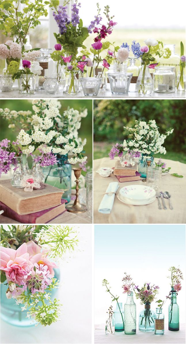Minus the books and change the colors, this is an ideal table setup - mismatched colored jars and candles, simple small flowers.