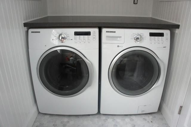 Smaller, counter depth front load washer and dryer in half