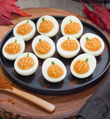 Your guests will love these miniature deviled eggs, made to look like tiny pumpkins, complete with stems! The chipotle chili powder gives them a spicy kick for even more irresistible flavor.