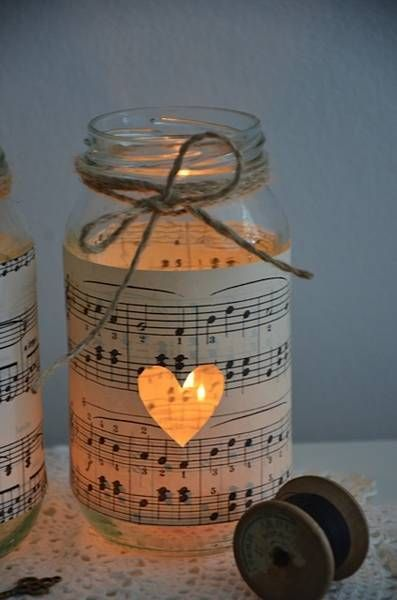 candles for the table, cover mason jar in sheet music and cut patterns into it