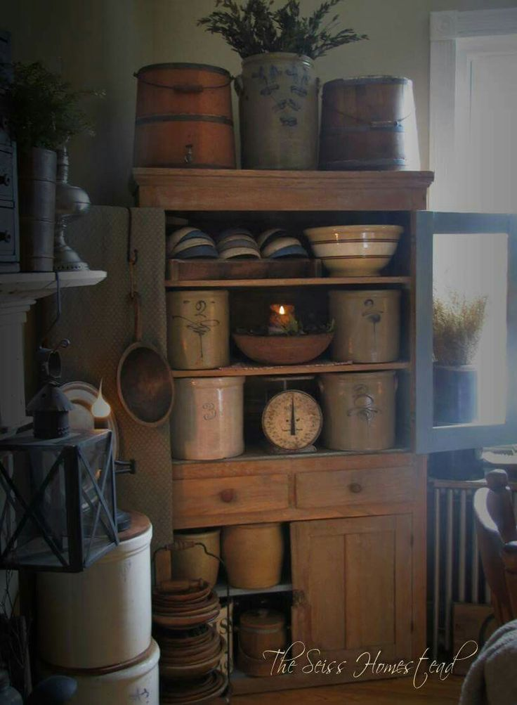 Great primitive cabinet full of antique crocks and farmhouse bowls