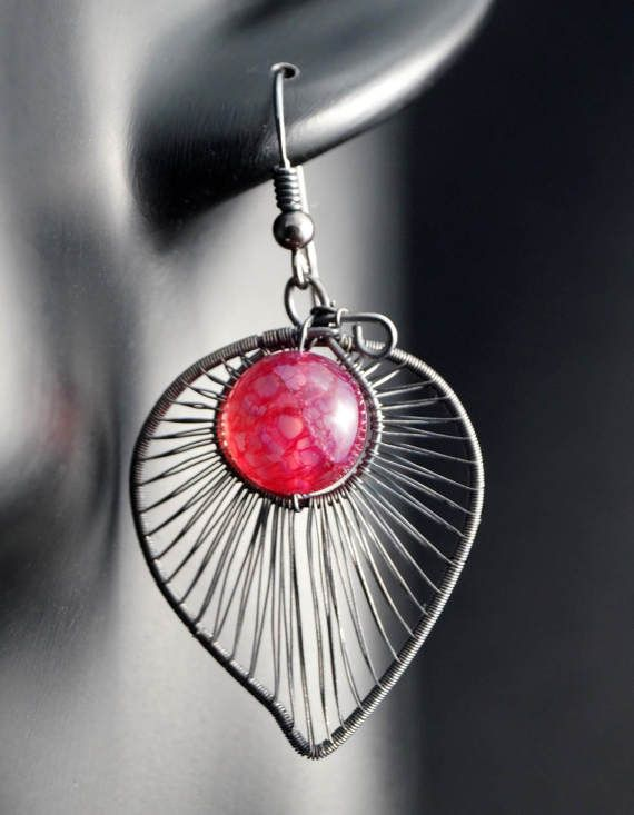 A delicate, unique, handmade, wire wrapped earrings with Dragon Veins Agate.  Earrings were designed and made by Me, using an extremely labor-intensive and precise wire-wrapping technique, with silver 925, 930 and 999. Whole strongly oxidized and polished.  Dimensions of earrings: length: 5 cm (1.96 inch) width: 2,3 cm (0.90 inch)  You receive these unique earrings in jewelry box, so theyre ready to be a gift.   Another items from the collection you may find here:  https://www.etsy...