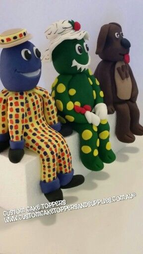 Dorothy the dinosaur, wags the dog and Henry the octopus cake toppers…