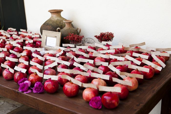 pomegranates are delicious. they remind me of late summer days during childhood getting my fingers all stained red to the dismay of my grandmother. what a perfect escort card idea. #nostalgicwedding