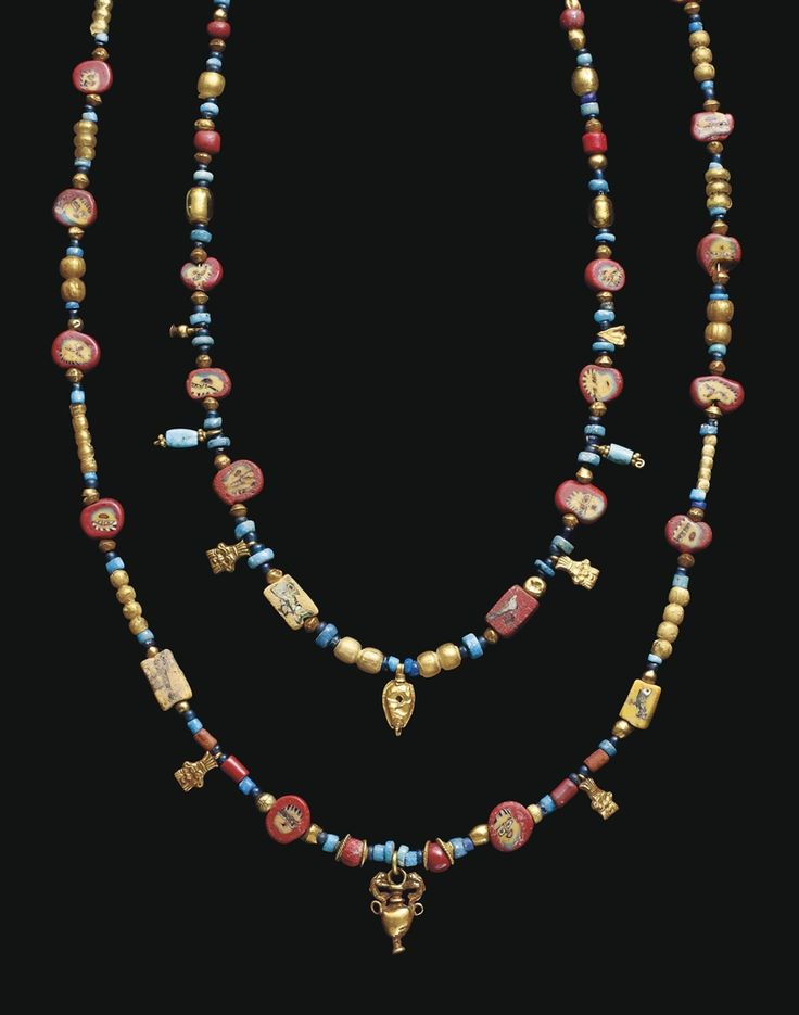 A ROMANO-EGYPTIAN GOLD AND GLASS BEAD NECKLACE CIRCA 200 B.C.-200 A.D.