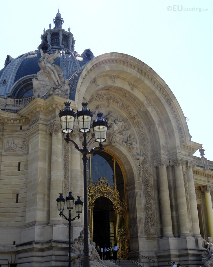 In this photo you can see the golden metal gate which gives access to the Petit Palais, the gates being intricate as well as the nearby incredible architecture and stone work around.  Want to learn more? Go to www.eutouring.com/images_petit_palais.html