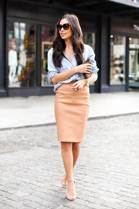 A camel pencil skirt and light blue denim/chambray shirt, tucked in - loving this look for work. Click for all 13 ways we're loving the pencil skirt for fall: