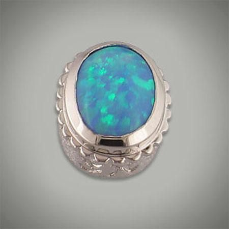 Faceted simulated opal oval bezel. Will fit any of the oval Caerleon collection of interchangeable jewelry. Designer:Goldman-Kolber $ 50.00 Item #: 8463 Call 870-863-8818 for personal consultation.