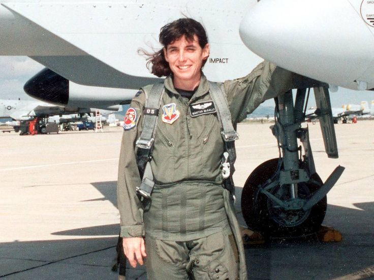 U.S. Air Force pilot Martha McSally, the highest ranking female fighter pilot, poses for a photograph in front of her aircraft at a military base in 1998.