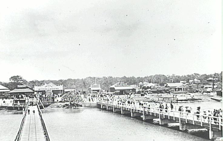 Redcliffe Jetty Opening Day - 1922 Photo taken from the sea looking back towards Redcliffe. Shows the old jetty and the new jetty with shops and houses in the background.