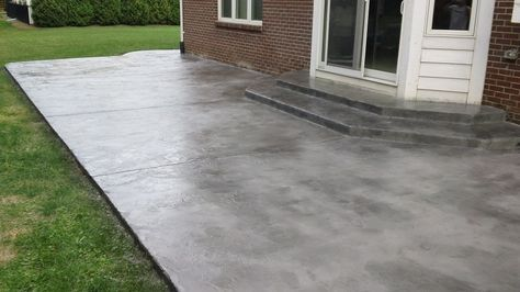 Here is an example of a concrete overlay applied to a normal concrete  patio. We stained it with Onyx water based stain and sealed it with a gloss  sealer that has a 8-10 year lifespan. I like this look because it takes on  the look of actual slate.