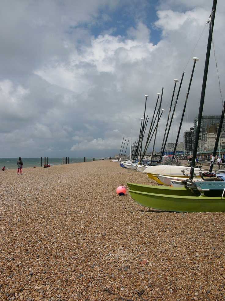 Array of sails lined up at the shores of the Brighton beach