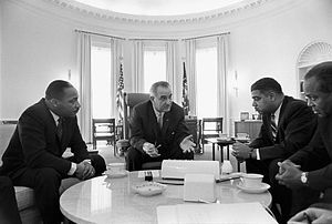 President Lyndon B. Johnson meets with Civil Rights leaders Martin Luther King, Jr., Whitney Young, and James Farmer IN January 1964, towards the end of the civil rights movement. This shows black individuals having a greater impact in politics.