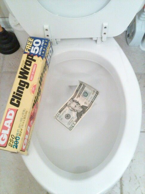 April Fools Day joke! Wrap the top of the toilet bowl is cling wrap. See the twenty dollar bill has been placed there to show you that you can NOT tell its there. Let the laughs begin lol!!!