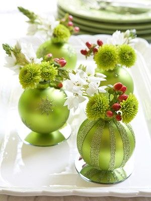 Table Christmas Decorations  Flowers in the opening of the ornaments. Glue ornaments to small craft mirrors. Voila!