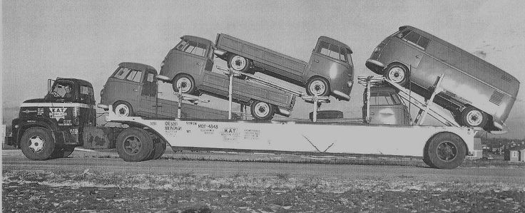 Old volkswagen type III single cabs and van on a transporter