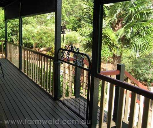 'Kensington' wrought iron personal access gate adds character to the verandah of this Queenslander on the Gold Coast Hinterland, QLD.