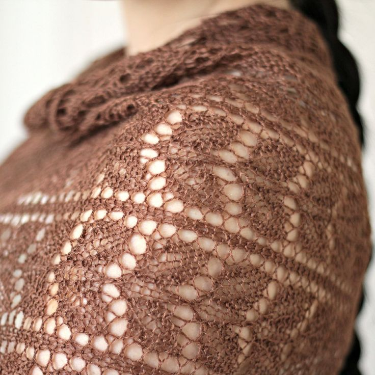 This hand knit lace stole is made of 50% merino/50% tussah silk in a warm brown color with a slight gold shade. Floral pattern along the stole makes it look very delicate and feminine. It's perfect wi