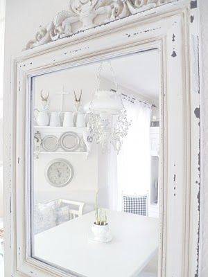 #White #mirror --and reflection shows dining area(?)...Mmmmmmm..........