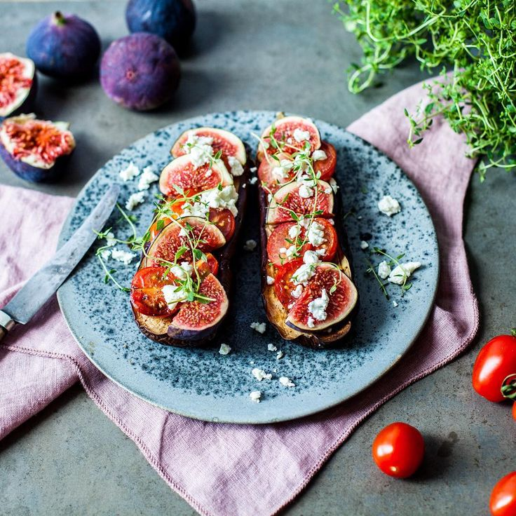 Baked aubergines with fig, tomato, feta cheese, and thyme.