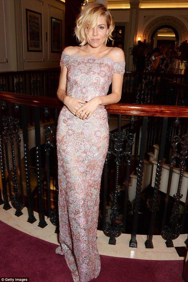 Sienna Miller in Burberry - 60th London Evening Standard Theatre Awards.  (November 30, 2014)