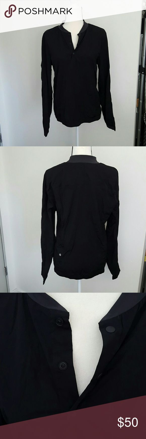 Lululemon Men's Windbreaker Pullover Lululemon Men's black Windbreaker Pullover with snaps at the neckline and a contrast gray collar. Excellent condition no flaws. lululemon athletica Jackets & Coats Lightweight & Shirt Jackets