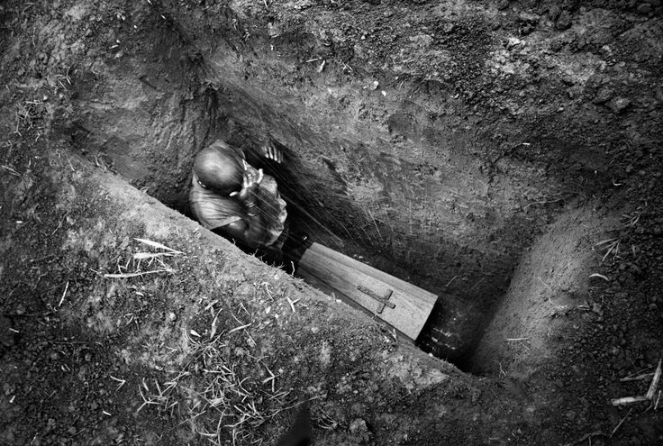 The burial of 8-month-old Sakura Lisi, the daughter of a gold miner in Mongbwalu in northeastern Congo. She died from anemia brought on by malaria. 2004. Marcus Bleasdale: When Photography Campaigns for Change - NYTimes.com