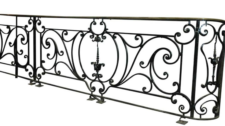 Ornate wrought iron stair railing and balcony