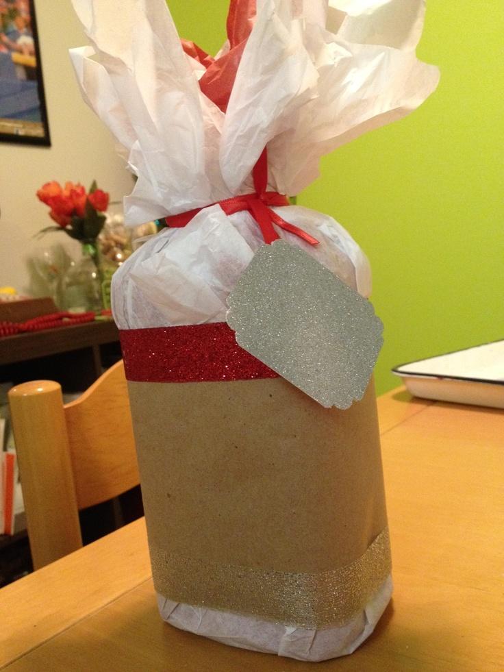 How to wrap a liquor bottle. #diy #holidaywrapping #liquor #glitter