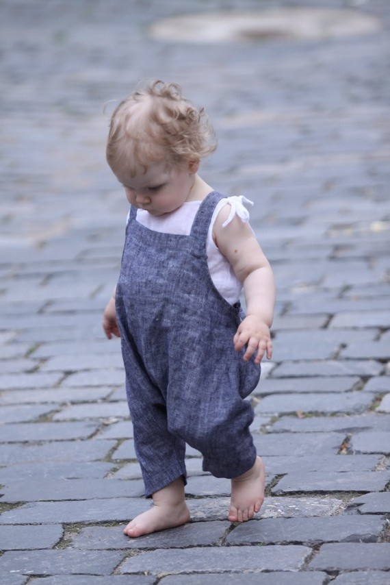 A child is the light of the world, but at the same time could be its darkness.  (Costumes. Modern. Casual baby outfit)