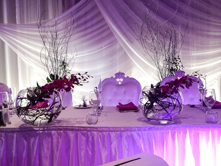 Headtable - purple on pink. Orchids and branches