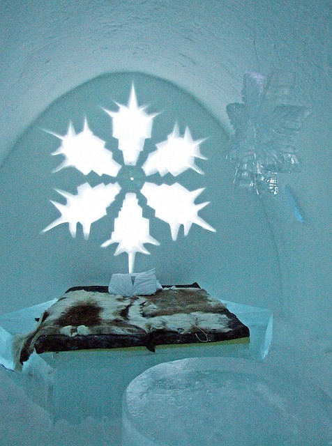 The Icehotel in the village of Jukkasjärvi, about 17 kilometres from Kiruna, in northern Sweden, was the world's first ice hotel. After its first opening in 1990, the hotel has been erected each year from December to April. The hotel, (including the chairs and beds), is constructed from snow and ice blocks taken from the nearby Torne River. The structure remains below freezing, around 23 °F (−5 °C)