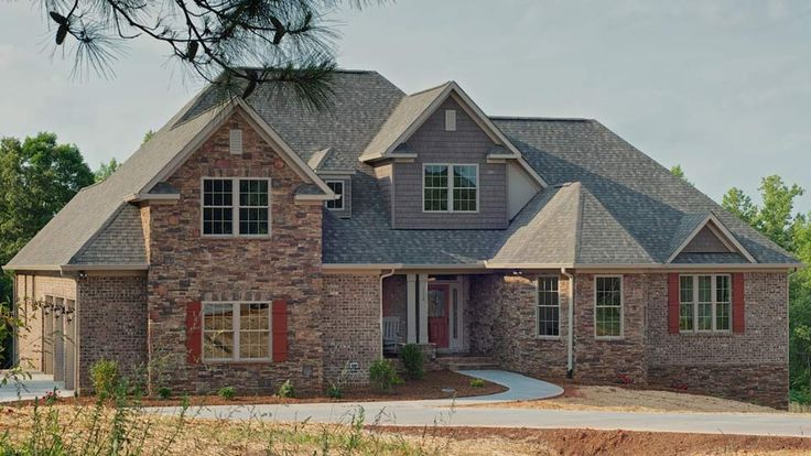 Craftsman style home by north point custom builders in for Rock and cedar homes