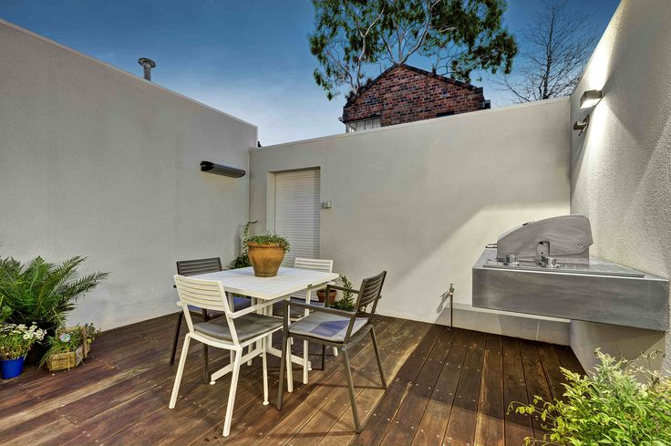 Construction & Interiors / Fitzroy Residence / Courtyard / Floating BBQ