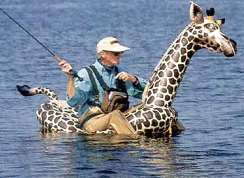 Fishing is fishing even on a inflatable giraffe funny for Walmart fly fishing