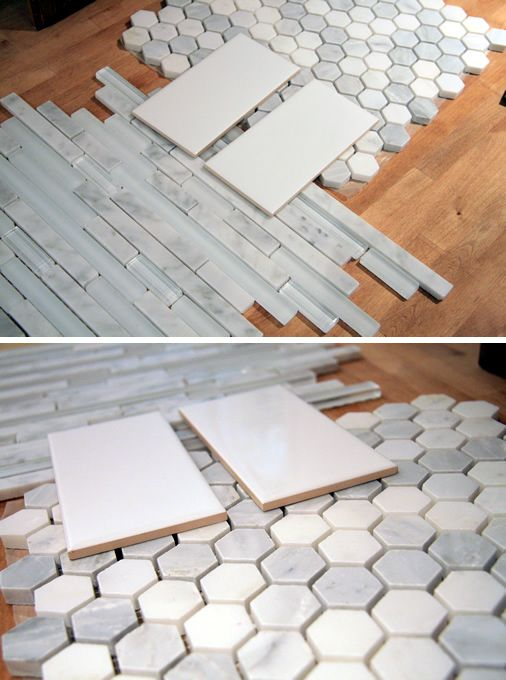 Marble hexagon tiles for floor. Subway tile for the bathroom walls. Horizaontal marble and glass tile for shower walls and accent strip at chair rail. Wow