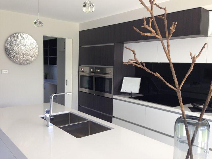 Good design kitchen showing butler's pantry with fridge inside sliding door
