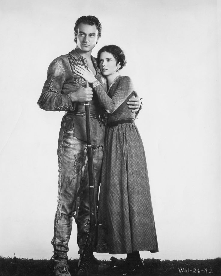 Wayne with co-star Marguerite Churchill.  Image: Michael Ochs Archives/Getty Images  Marion Robert Morrison was born in Iowa in 1907, and moved with his family to California in 1916. He dropped out of the University of Southern California after breaking his collarbone in a bodysurfing mishap and losing his football scholarship.