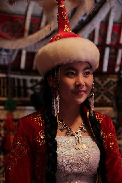 A Kazakh bride in her traditional red wedding costume