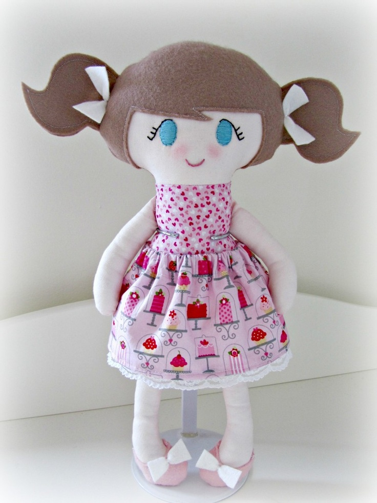 Handmade fabric doll made using designer cottons, 100% wool felt and filled with soft polyester filling. Her pink skirt is removable and her face has been hand embroidered. She stands at 40cm tall and is CE marked so safe for children and suitable from birth.