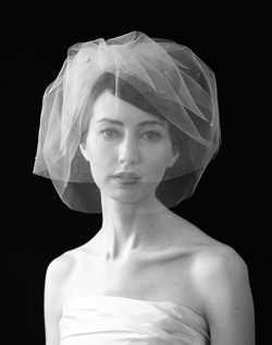 "Now let's look at some veils.  This particular style is called the ""Birdcage Veil."" It has multiple short layers and is flattering on almost any woman."