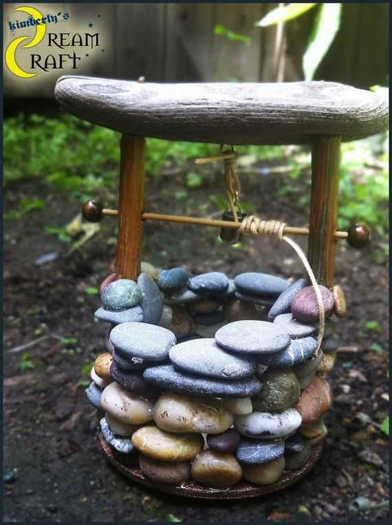 Some thing like this with water gushing out as the start of a stream/waterfall would be so cute.