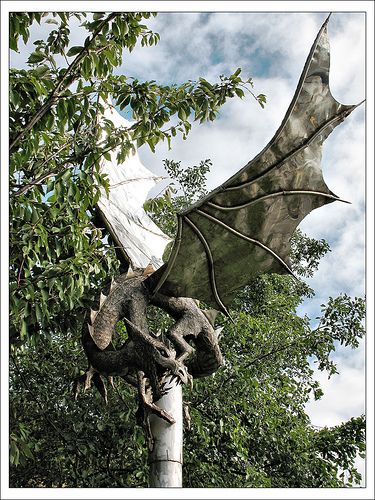 The Sneinton Dragon stands at the junction of Manvers Street and Sneinton Hermitage in Nottingham. Made from stainless steel it is 7 feet tall with a 15 foot wingspan. Local craftsman Robert Stubley sculpted the dragon after residents chose the theme.