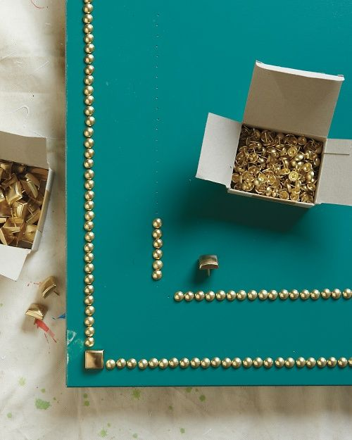 Instructions for adding nailhead trim to a door.