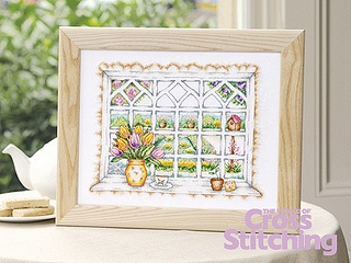 Springtime scene – garden cross stitch project by The World of Cross Stitching magazine, in issue 201