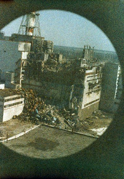 Chernobyl: 27 April, 1986: The first photo to be taken of the reactor, at 4pm, 14 hours after the explosion. This was taken from the first helicopter to fly over the disaster zone to evaluate radiation levels. The view is foggy due to radiation, which also explains why the shot was not taken too close to the window.