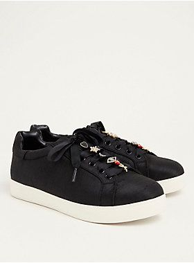 An exclusive collection presented by Circus by Sam Edelman. The black woven outer gives this lace up sneaker - a street-style classic - an elevated touch. The lace up ties have been carefully detailed with rhinestone-embellished charms - like a rose and a crescent moon.   Circus by Sam Edelman 2017 Fall Collection; available in wide width exclusively for Torrid  TRUE WIDE WIDTH: Designed so you never have to size up again.  Man-made materials  Imported