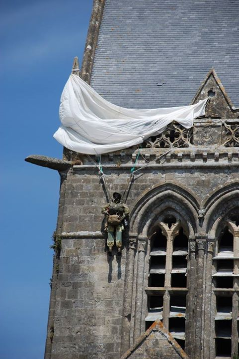 The most photographed paratrooper in Normandy the monument to John Steele who was caught on the Sainte-Mère-Église church spire during D-Day
